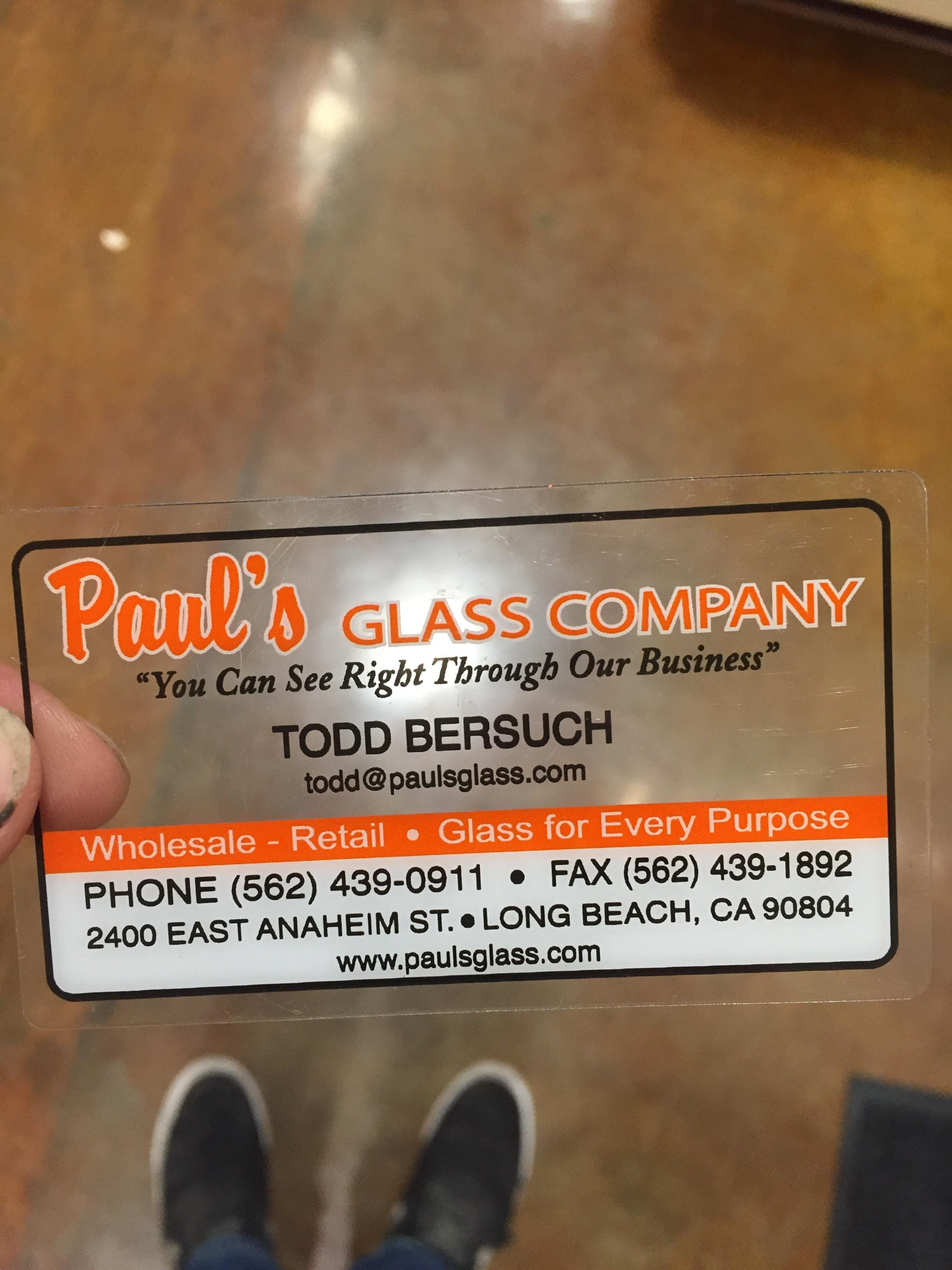 PUT ME LIKE · This glass company uses transparent business cards.