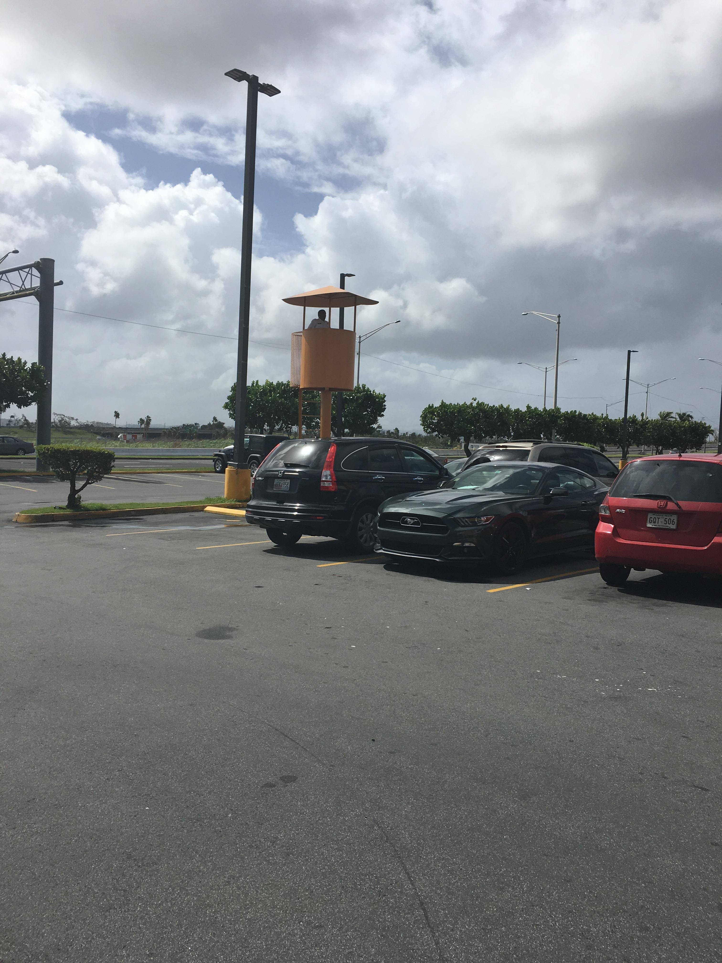 instead of a security camera this walmart parking lot in puerto rico has a security guard watch tower put me like · instead of a security camera, this walmart parking