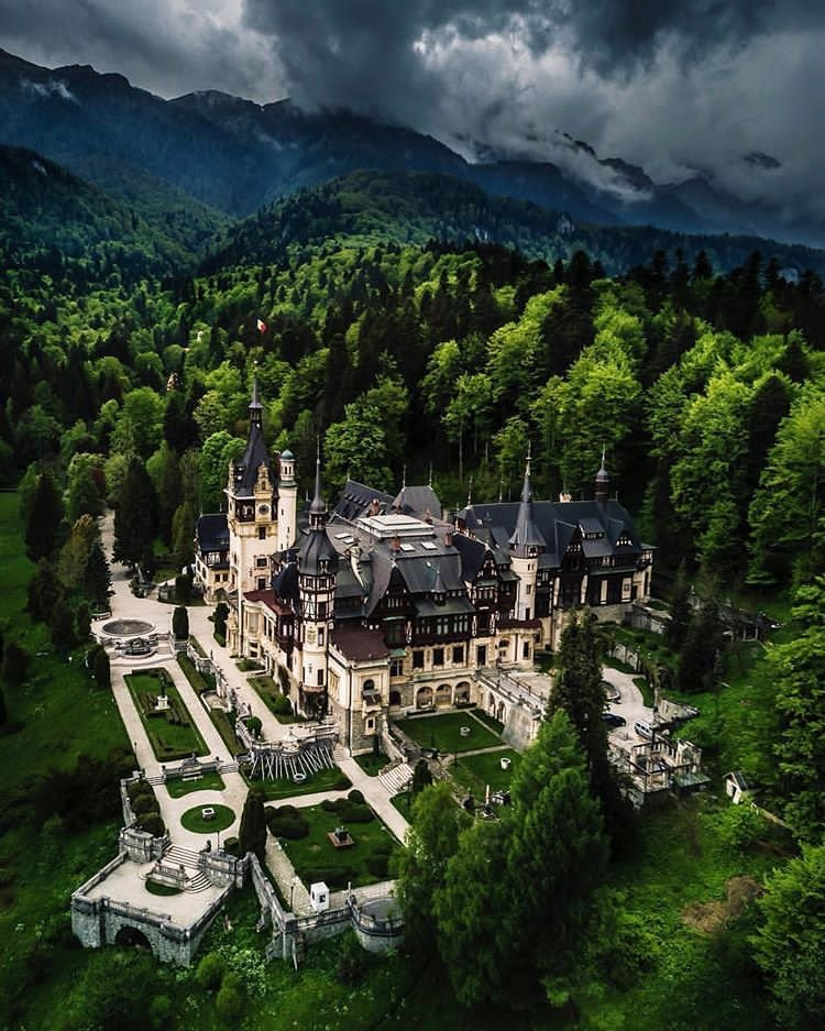 peles castle nestled in the carpathian mountains put me like