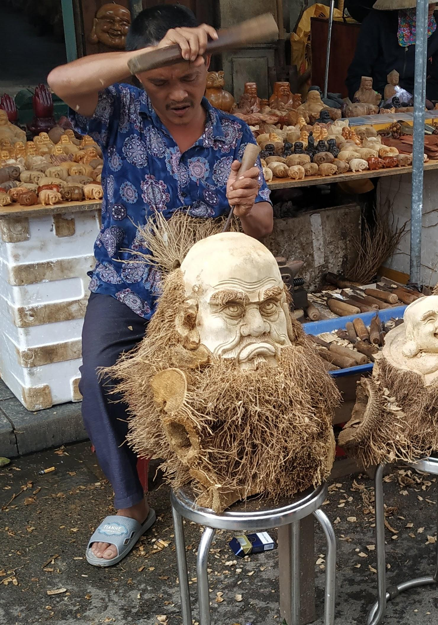 Sculpture made from a tree stump using the roots as facial hair